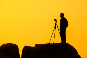 Photographer against a sunset